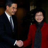 Carrie Lam, Hong Kong's newly elected leader, meets current Chief Executive Leung Chun-ying in the city on Monday. | REUTERS