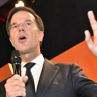 Dutch incumbent Rutte beats anti-Islam leader Wilders in year's first poll defeat of Europe populist