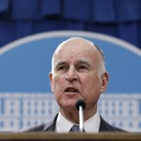 Jerry Brown swipes at 'strongman' Trump over border wall, says California to fight