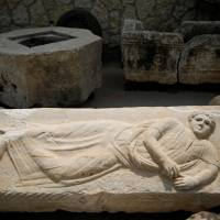 A reclining figure engraved on the lid of a sarcophagus is seen at Israel's National Treasures Storeroom, in Beit Shemesh, Israel, Sunday. | REUTERS