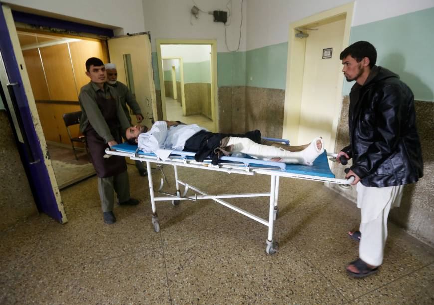 Survivors of Kabul hospital attack deadly to over 100 say insiders also took part