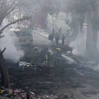 At least one killed when suicide car bomber rams Kabul telecom bus during rush hour