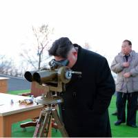 This undated picture released by North Korea's Korean Central News Agency (KCNA) via KNS on Tuesday shows North Korean leader Kim Jong Un supervising the launching of four ballistic missiles by the Korean People's Army (KPA) during a military drill at an undisclosed location in North Korea. Nuclear-armed North Korea launched four ballistic missiles on Monday in another challenge to President Donald Trump, with three landing provocatively close to America's ally, Japan. | KCNA VIA KNS / AFP-JIJI