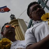 Malaysia says it will give Kim's family time to claim body