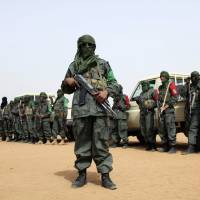 Tuareg rebels join Mali army to patrol against extremists under joint peace deal