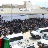 African migrants gather March 22 at the Tripoli branch of the Anti-Illegal Immigration Authority, in the Libyan capital. Libya had rescued 420 migrants trying to cross the Mediterranean to Europe, navy spokesman Gen. Ayoub Qassem said on March 20, but three were found dead and 30 reported missing. | AFP-JIJI
