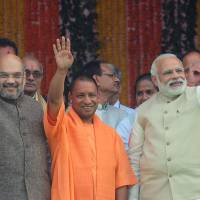 Uttar Pradesh Chief Minister Yogi Adityanath (center), Indian Prime Minister Narendra Modi (right) and Bharatiya Janata Party President Amit Shah attend Adityanath's swearing-in ceremony as chief minister in Lucknow, the state capital, on Sunday. | AFP-JIJI