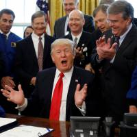 Trump inks first bill authorizing NASA funding in seven years