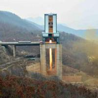 North Korea tests a new high-powered engine at the country's Sohae satellite facility in Dongchang-ri on Saturday in this photo published by the state-run Rodong Sinmun daily Sunday. | KYODO