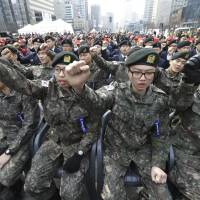 South Korean army soldiers shout slogans against the North Korea during a ceremony in Seoul on Friday to commemorate South Korean soldiers killed in three major clashes with North Korea in the West Sea. According to U.S. defense officials, North Korea is now in the final stages of preparing for yet another nuclear test that could come in the next few days. | AP