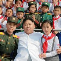 North Korean leader Kim Jong Un arrives for a performance by schoolchildren, called 'We Are the Happiest in the World,' to celebrate the 70th anniversary of the Korean Children's Union in this undated photo released by North Korea's official Korean Central News Agency. | REUTERS