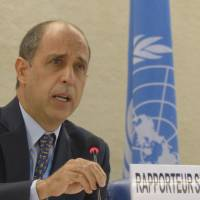 Tomas Ojea Quintana, the U.N. special rapporteur on human rights in North Korea, speaks to the Human Rights Council in Geneva on Monday. | AP