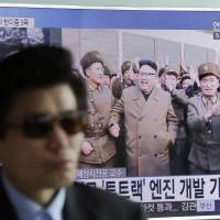 A TV news program shows an image, published in North Korea's Rodong Sinmun newspaper, of North Korean leader Kim Jong Un at the country's Sohae launch site, at Seoul Railway station in the South Korean capital Sunday. | AP