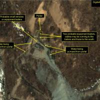 Activity at the Punggye-ri nuclear test site, seen in commercial satellite imagery taken Saturday, 'strongly suggests' that preparations for North Korea's sixth atomic test are entering the final stages, a U.S. think tank has said. | DIGITAL GLOBE / 38 NORTH / GETTY / VIA KYODO