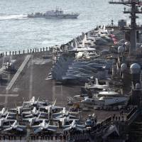 The U.S. aircraft carrier USS Carl Vinson arrives for the annual Foal Eagle joint military exercise between South Korea and U.S., at the port of Busan, South Korea, on Wednesday. | REUTERS