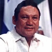Panamanian strongman Manuel Noriega takes part in a news conference in Panama City on Oct. 11, 1989. | REUTERS
