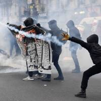 Anarchists stage riot at end of Paris protest march over police violence