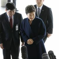 Ousted South Korean leader Park Geun-hye arrives at a prosecutor's office in Seoul on Tuesday. | AP