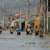 Deadly Peru floods, slides rage on as more downpours loom, cities call for help