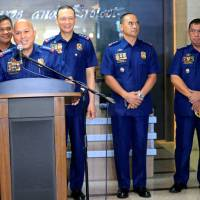 Philippine National Police Chief Ronald dela Rosa speaks with Senior Superintendent Graciano Mijares (right), newly appointed head of the drug enforcement group, in attendance at a news conference in Manila on Monday to relaunch anti-drug operations. | REUTERS