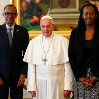 Pope Francis poses with Rwanda's President Paul Kagame and his wife, Jeannette, during a private meeting at the Vatican Monday. | REUTERS