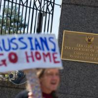 Protesters march against U.S. President Donald Trump outside the Russian Embassy in Washington on Saturday. | AFP-JIJI