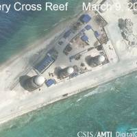 Construction is shown on Fiery Cross Reef, part of the Spratly Island chain in the disputed South China Sea, in this March 9 satellite image. | REUTERS