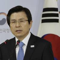 South Korea's acting leader Hwang turns down resignation offer by Park aides