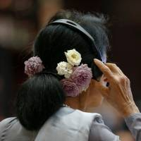 Myanmar State Counsellor Aung San Suu Kyi attends the ASEAN summit in Vientiane last September. | REUTERS