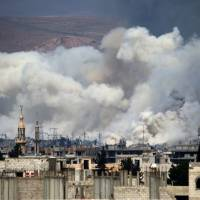 Suicide bombers kill 30 in Damascus as Syria enters seventh year of war