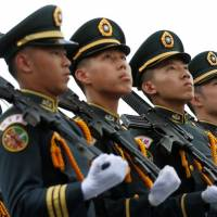 Taiwanese cadets march during a ceremony to mark the 92nd anniversary of the Whampoa Military Academy, in Kaohsiung, Taiwan, last June. | REUTERS