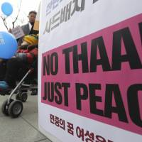 South Koreans demonstrate against deployment of the Terminal High Altitude Area Defense anti-missile system  in Seoul on Wednesday. | AP