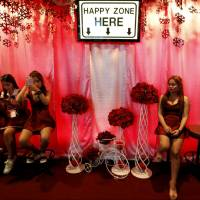 Women sit outside a go-go dance bar in Pattaya, Thailand, on Saturday. | REUTERS