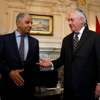 U.S. Secretary of State Rex Tillerson greets Iraqi Oil Minister Jabbar al-Luaibi at the State Department in Washington on March 10. | REUTERS