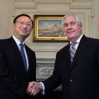 U.S. Secretary of State Rex Tillerson shakes hands with Chinese State Councilor Yang Jiechi, the country's top diplomat, before their meeting at the State Department in Washington on Tuesday. | AFP-JIJI