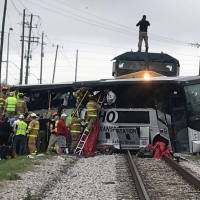 Three killed when freight train hits bus apparently stuck on Biloxi crossing