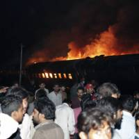 At least one dead as Pakistan passenger train hits stuck oil truck, becomes inferno