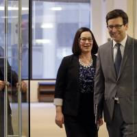 Washington State Attorney General Bob Ferguson arrives for a news conference about the state's response to President Trump's revised travel ban with Solicitor General Noah Purcell (left) and Civil Rights Unit Chief Colleen Melody Thursday in Seattle. | AP