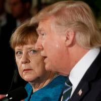 Trump, Merkel try to sidestep differences in first meeting