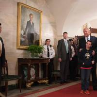 Trump greets first wave of White House tourists under portrait of Hillary