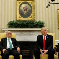 Trump hosts Iraqi leader on 14th anniversary of U.S. invasion, says Mosul mission 'moving along'