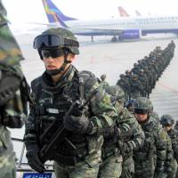 Chinese forces rumble through Uighur-dominated Urumqi in new display