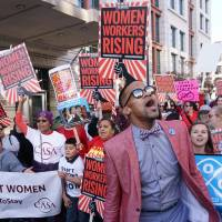 Women stage strikes in U.S. to demonstrate economic clout, protest Trump