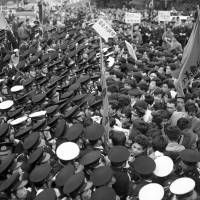 Students protesting against the U.S.-Japan security treaty clash with police near the Diet building in April 1960. The movement would grow to be one of the largest in Japan's history.