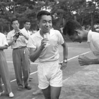 Crown Prince Akihito, who would become the Emperor in 1989, enjoys a drink after a game of tennis in Kamakura, Kanagawa Prefecture, in July 1958.