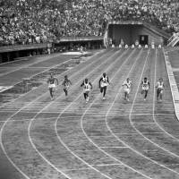 Runners compete in a qualifying heat of the men's 100-meter dash during the Tokyo 1964 Olympics. U.S. athlete Bob Hayes won the gold medal that year, with a time of 10.0 seconds.
