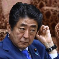 Prime Minister Shinzo Abe awaits questions during an appearance before the Upper House Budget Committee on Friday.    AFP-JIJI