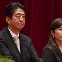 Prime Minister Shinzo Abe and Defense Minister Tomomi Inada attend the graduation ceremony of the National Defense Academy in Yokosuka, Kanagawa Prefecture, on Sunday. | AFP-JIJI