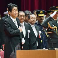Abe warns defense academy grads of 'severe' security situation, need for stronger defenses