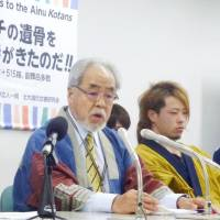 Masaki Sashima, chairman of an Urahoro-based Ainu association, speaks at a news conference in Sapporo on Wednesday. | KYODO